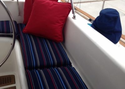 Yacht Upholstery Navy Blue Stripes and Pillows Red
